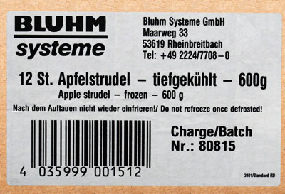 Weißes Kartonetikett mit Adresse und Barcode