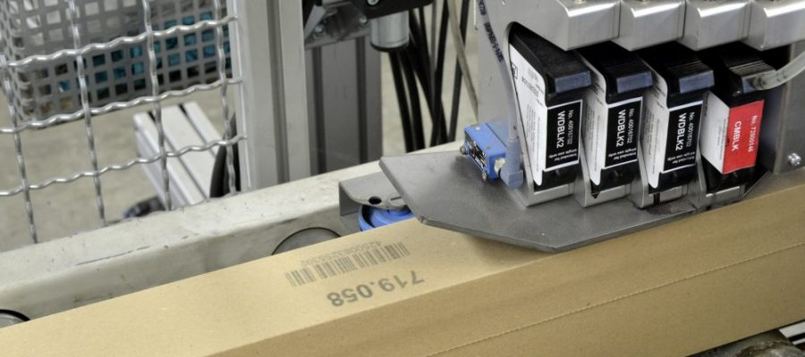An inkjet printer marking a box
